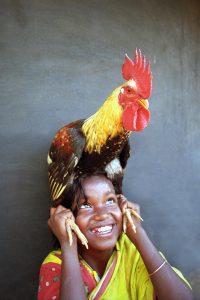 Child with chicken (Source: Nimai Chandra Ghosh/Photoshare)